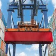 Shore crane lifts container during cargo operation...