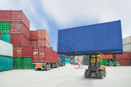 Photo for Forklift handling container box loading to truck in import export logistic zon - Royalty Free Image