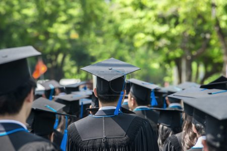 Photo for Back of graduates during commencement at university - Royalty Free Image