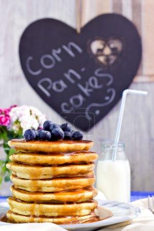 Corn pancakes with caramel sauce blueberries, selective focus
