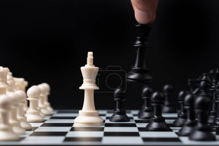Photo for Hand businessman moving chess on a chessboard - Royalty Free Image