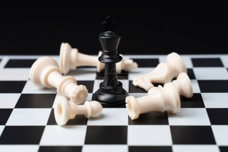Photo for The winner chess on a chessboard background - Royalty Free Image