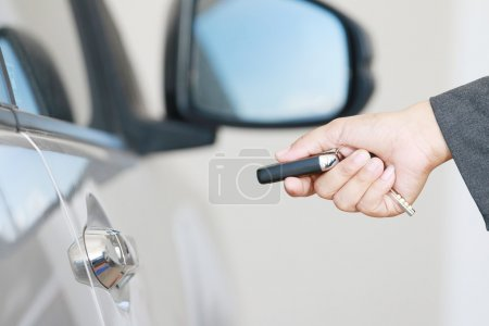 Business woman operate remote key car