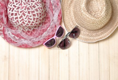 Photo for Sunglasses, hat, concept summer vacation on wooden background. - Royalty Free Image