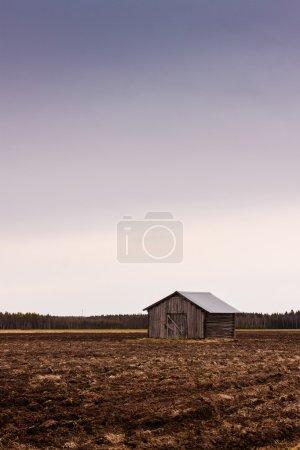 Old Barn On An Empty Field