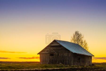 Barn House Against The Spring Sunset