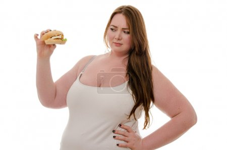 fat woman eating hamburger isolated on white background