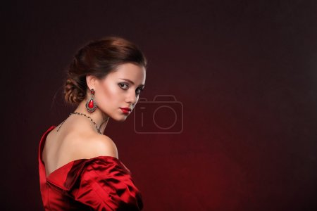 Beautiful woman in red dress with professional make up