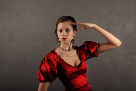 Photo for Beautiful woman in red dress with professional make up studio - Royalty Free Image