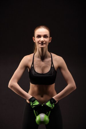Athletic young woman doing a fitness workout with weights. Fitness girl