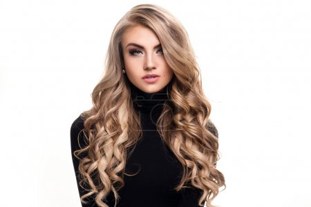 Photo for Portrait of young beautiful blonde woman with long curly hair and glamour makeup. Girl looking at camera. White background. Black and white style. - Royalty Free Image