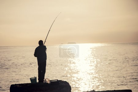 Man fishing at the morning.