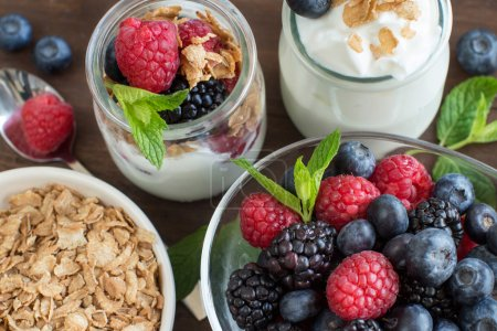 Photo for Healthy breakfast with Fresh greek yogurt, flakes  and berries - Royalty Free Image