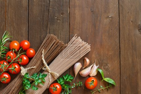 Three types of spaghetti, tomatoes and herbs