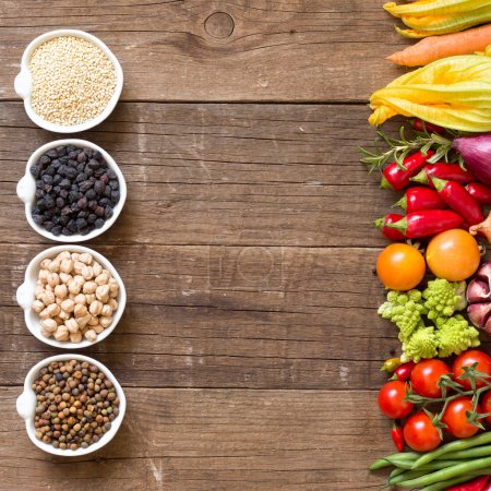 Photo for Cereals, legumes and vegetables on a wooden table - Royalty Free Image