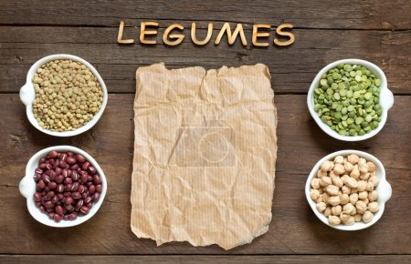 Photo for Variety or legumes, word Legumes and paper on a wooden table - Royalty Free Image