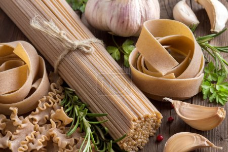 Photo for Whole wheat italian pasta with  garlic and herbs - Royalty Free Image