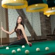Постер, плакат: Sexy girl in corset plays billiards