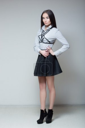 girl in a black skirt and shirt with straps