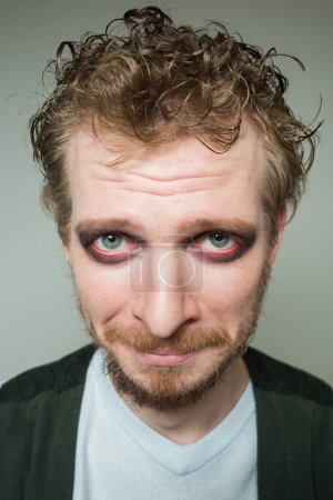 prortret guilty of a bearded man with makeup.