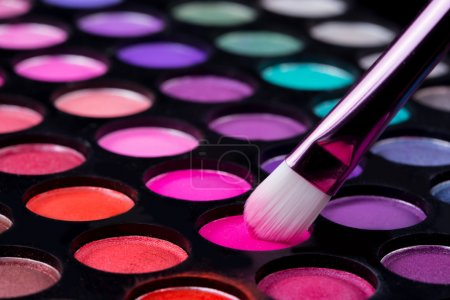 Photo for Makeup brushes and make-up eye shadows.  black background - Royalty Free Image