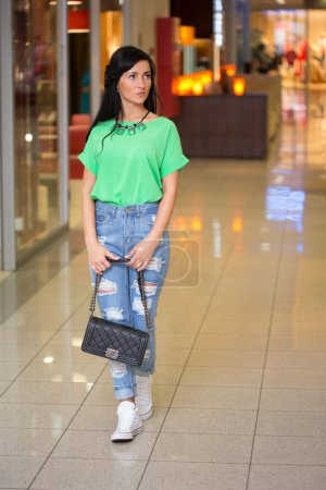 Photo for Pretty girl in short shert the mall - Royalty Free Image