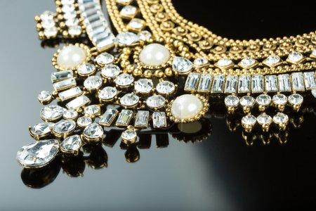 metal feminine necklace. on black  background.