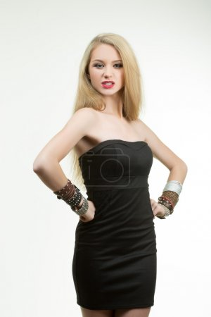 Photo for Portrait of beautiful young blond woman in multiple bracelets - Royalty Free Image