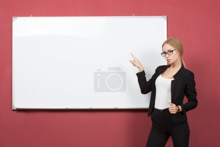 business woman pointing at the whiteboard