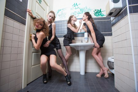 drunk girl in toilet bars. women in evening dresses in alcoholic intoxication