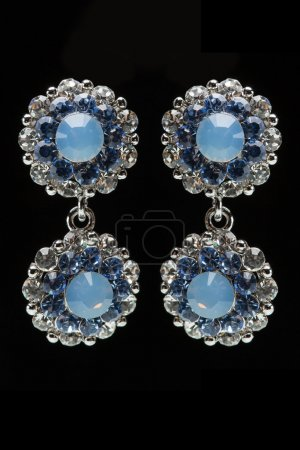 Earrings with blue stones on the black