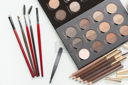 Eye shadows of different colors and make-up brushes