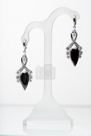 Earrings with black stones on the white