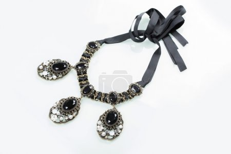 Black necklace with stones on white
