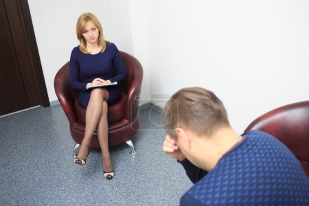 psychologist consulting pensive man during psychological therapy session