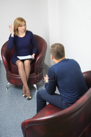 Photo for Female psychologist consulting pensive man during psychological therapy session - Royalty Free Image