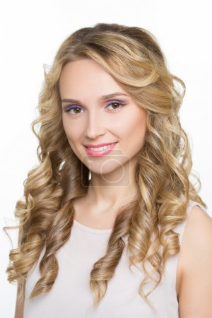 Photo for Beautiful woman with long blond curly hair. Isolated on white - Royalty Free Image