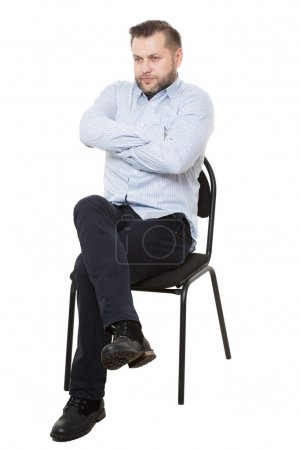 Photo for Man sitting on chair. Isolated white background - Royalty Free Image
