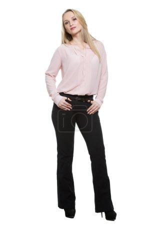Photo pour Fille en pantalon et blouse. Isolé sur fond blanc. langage corporel - image libre de droit
