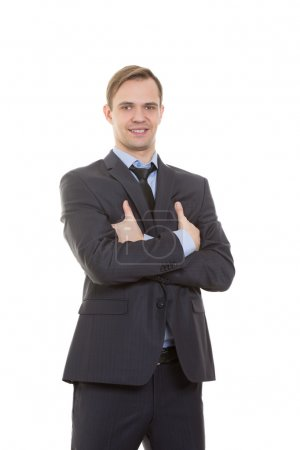 body language. man in business suit isolated white background. gestures of arms and hands. posture of superiority. emphasis thumbs. crossed arms