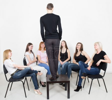 Coach and support group during psychological therapy. women on training, looking at man dreams