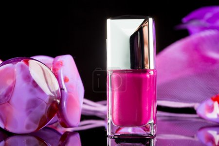 Magenta nail polish on  background of womens accessories