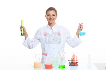 Very beautiful Woman chemist and chemicals in flasks, isolated on white