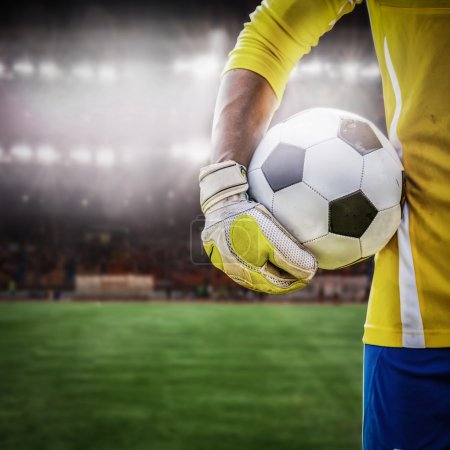 Close up goalkeeper holding soccer ball
