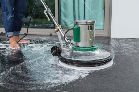 Exterior stone floor cleaning with polishing machine and chemica