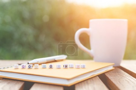 Photo for Good morning written in letter beads and a coffee cup on table - Royalty Free Image