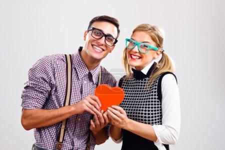 Portrait of happy nerdy couple