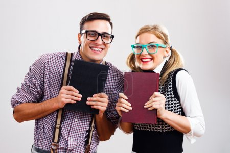 Nerdy man and woman with books