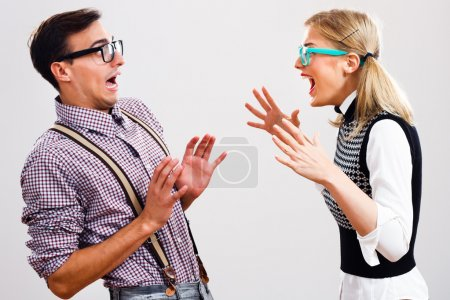 Nerdy woman is shouting at her boyfriend