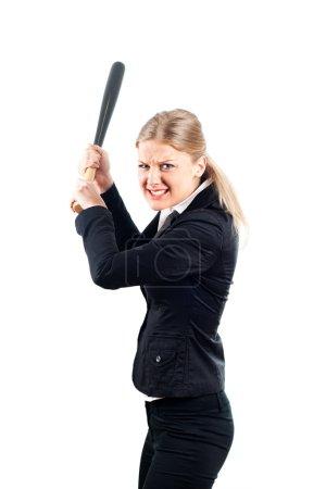Frustrated businesswoman holding baseball bat